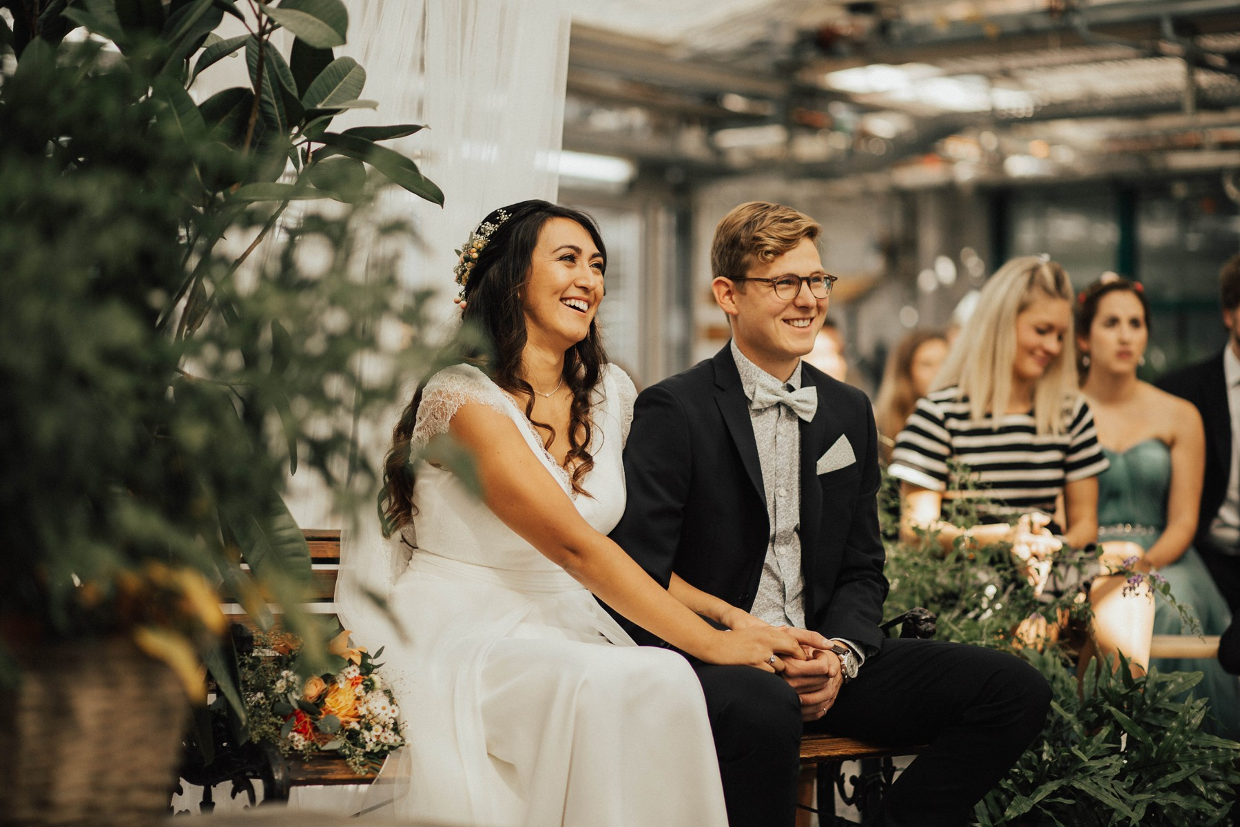 bride and groom sitting during the ceremony