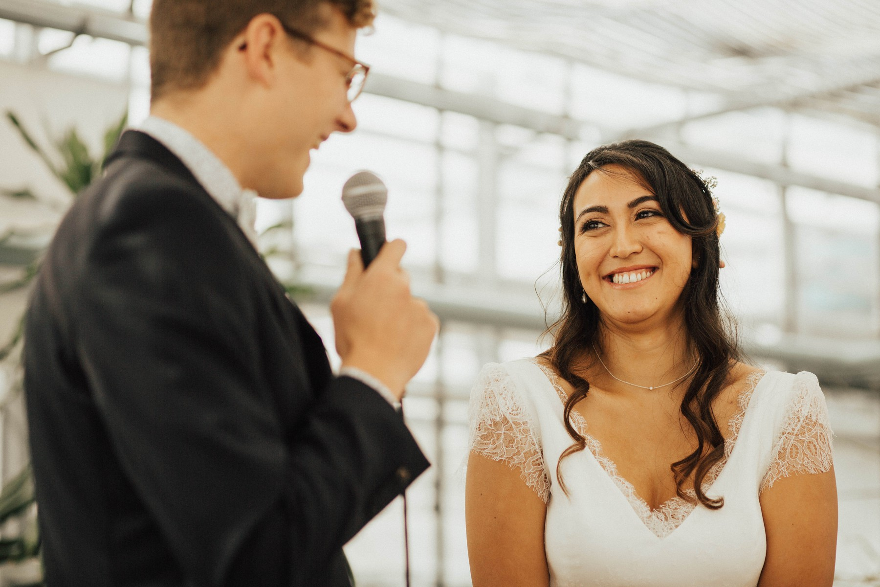 groom says vows to his soon to be smiling bride