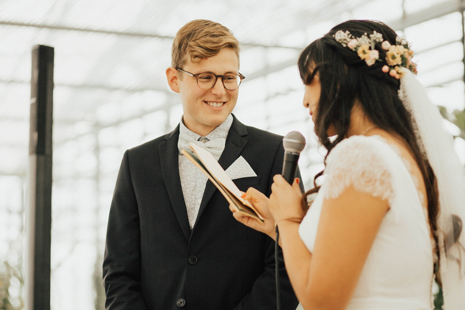 happy groom while hearing vows
