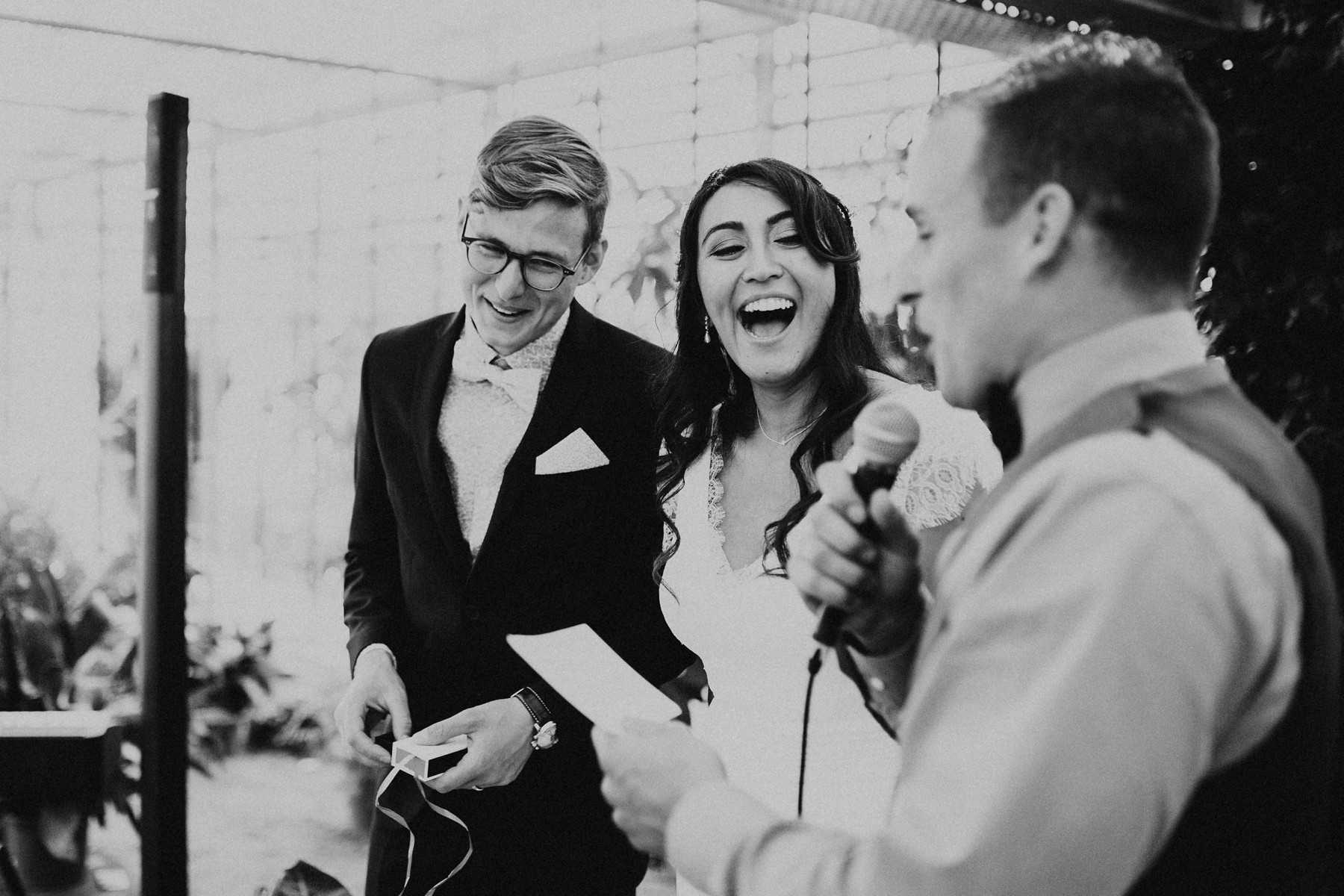 happy couple laughing during wedding ceremony