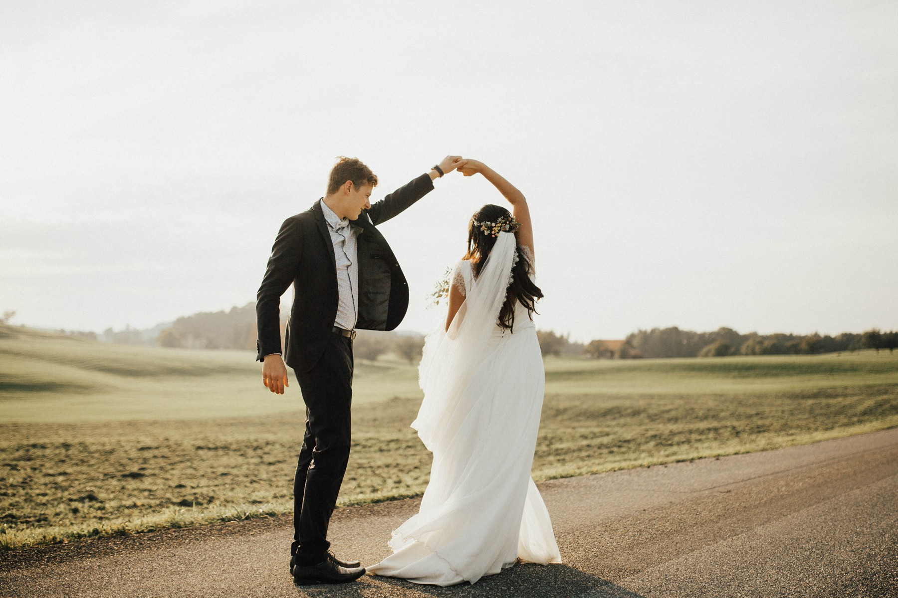 dancing newlyweds in sunset